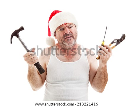 Frustrated dad on Christmas Eve holding tools to assemble gifts.  Isolated on white.   - stock photo