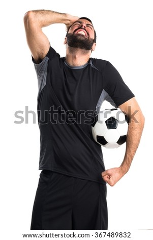 frustrated Football player  - stock photo
