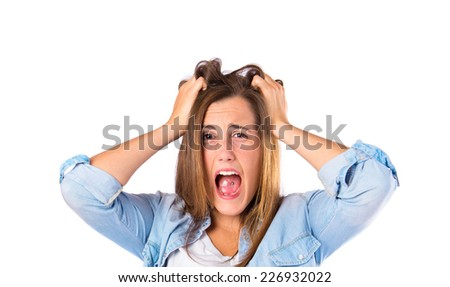 frustrated girl over isolated white background - stock photo