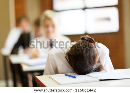 frustrated high school student in classroom - stock photo