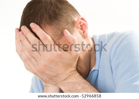 frustrated man in a blue shirt on a white background - stock photo