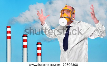 Frustrated man in gas mask above smoke contaminated sky. Ecology concept. - stock photo