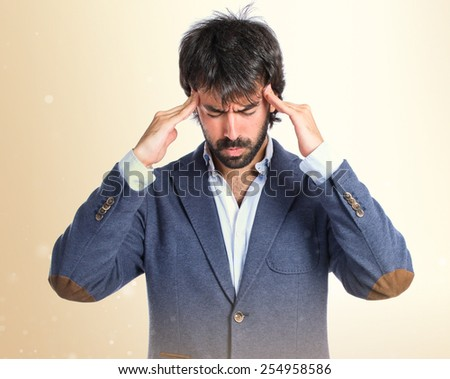 frustrated man over isolated white background - stock photo