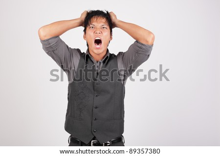 Frustrated man pulling out his hair