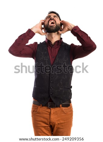frustrated man wearing waistcoat - stock photo