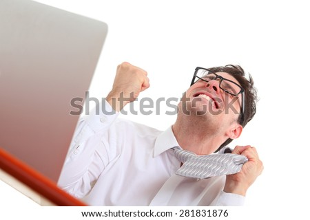 frustrated man with computer on white background - stock photo