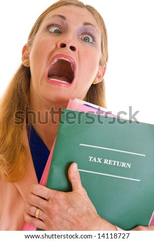 Frustrated, middle-aged executive business woman holding tax return which caused her eyes to cross. - stock photo
