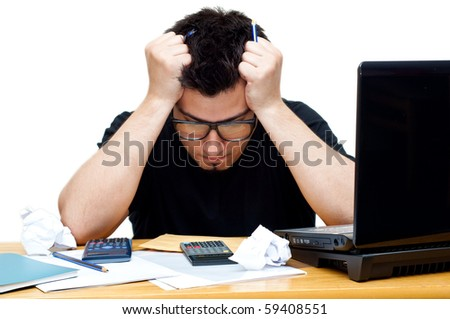 frustrated nerdy accountant at his desk isolated - stock photo