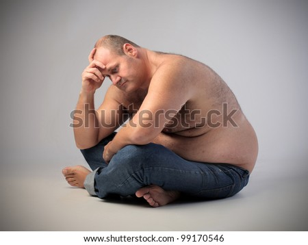 Frustrated overweight man - stock photo