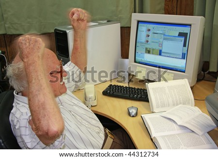 Frustrated Senior at Computer - stock photo