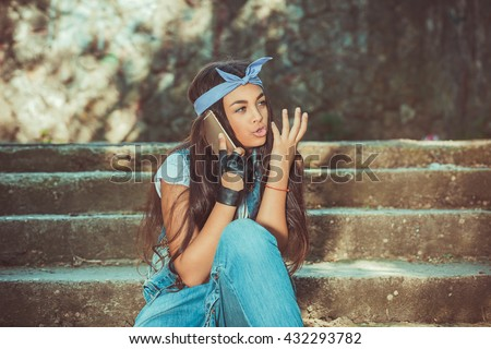 Frustrated skeptical phone talking. Closeup portrait upset angry skeptical stressed unhappy serious woman talking on mobile phone outdoors. Human emotion face expression feeling reaction body language - stock photo