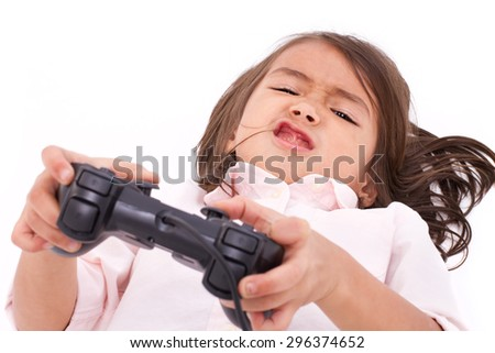 frustrated, upset, angry little girl gamer experiencing game over - stock photo