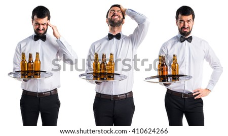 frustrated waiter with beer bottles on the tray  - stock photo