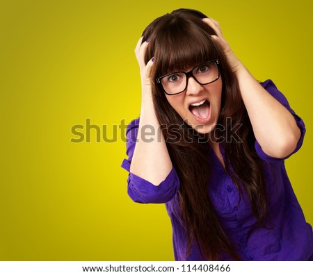 Frustrated Woman With Mouth Open Isolated On Yellow Background - stock photo