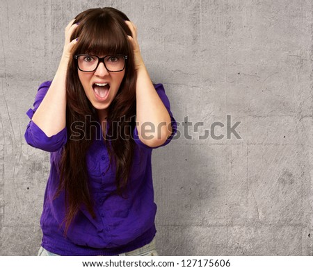 Frustrated Woman With Mouth Open On Wall - stock photo