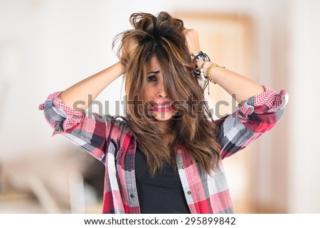frustrated young girl on unfocused background - stock photo