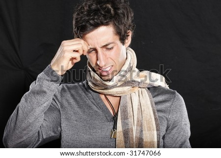 Frustrated Young Man Touching Brow - stock photo