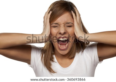 frustrated young woman screaming - stock photo