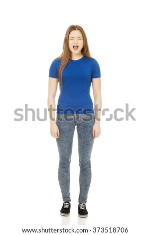 Frustrated young woman screaming. - stock photo