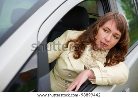 Frustrated young woman stuck in a traffic jam - stock photo