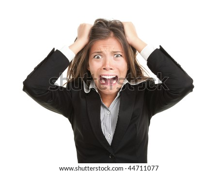 Frustration. Frustrated and stressed young businesswoman in suit. Beautiful young mixed race asian / caucasian woman isolated on white background.