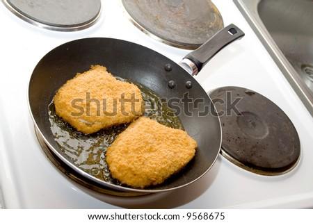 frying chops - stock photo