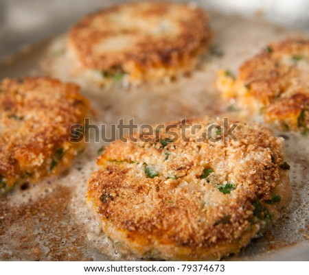 Frying Crab Cakes in Stainless Steel Skillet - stock photo