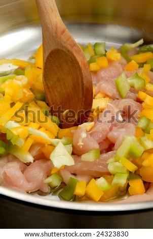 Frying meat and vegetables - stock photo