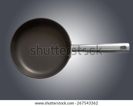 Frying pan against gray background. Top view. - stock photo