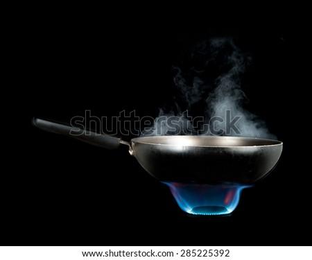 Frying Pan and smoke on Burner - stock photo