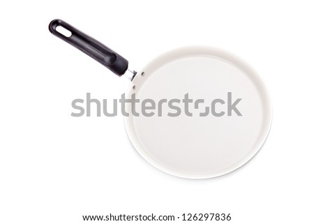 Frying pan for pancakes. Isolated on white - stock photo