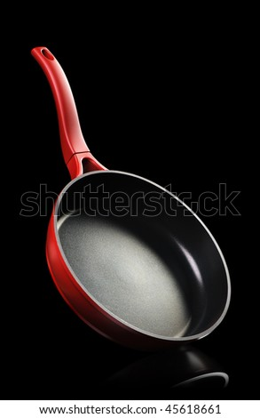Frying pan - kitchen utensils It is isolated on a blsck background - stock photo