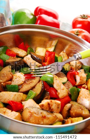 frying pan with  chicken and vegetables - stock photo