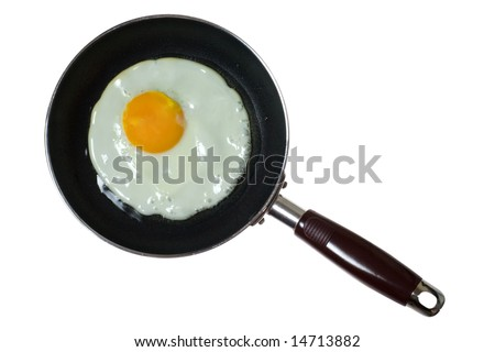 Frying pan with sunny side up egg isolated on white background - stock photo