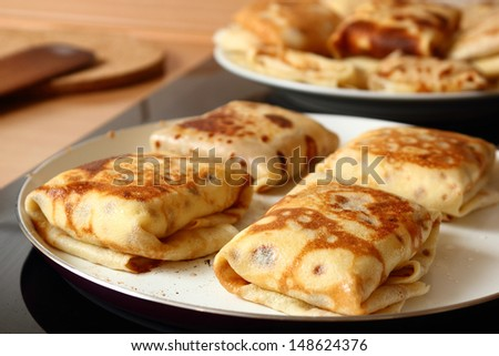 Frying pancakes with fillings. Traditional russian pancakes (blini) with curd. Cheese blintzes. - stock photo