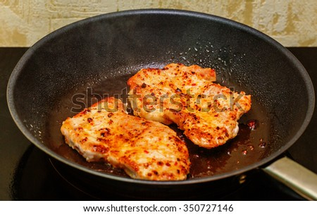 Frying pork with sweet oil on skillet  - stock photo
