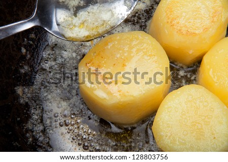 Frying potato slices in a pan.  - stock photo