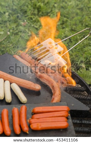 Frying sausages at barbecues and burning oil.