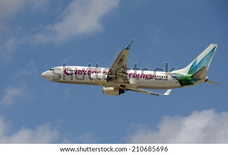 FT LAUDERDALE - APRIL 19: Caribbean Airlines Boeing 737 passenger jet departs from Fort Lauderdale Florida to Trinidad on April 19, 2014. The airline connects the USA with many Caribbean islands. - stock photo
