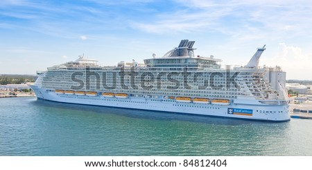 FT. LAUDERDALE, FL - JULY 10: Royal Caribbean's, Allure of the Seas, docked in Pt. Everglades on July 10, 2011 in Fort Lauderdale. It's the largest passenger ship ever built, just 2.0 in. longer the Oasis of the Seas. - stock photo