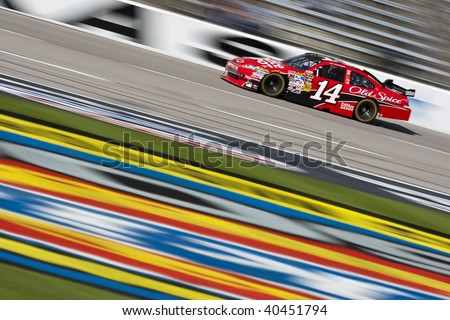 FT. WORTH, TX - NOV. 6:Tony Stewart brings his Office Depot Chevrolet through the frontstretch during a practice session for the Dickies 500 race in Ft. Worth, TX on Nov. 6, 2009. - stock photo