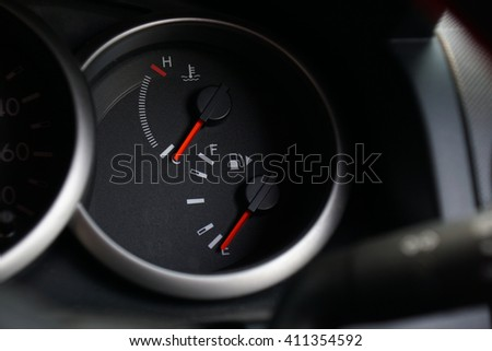 Fuel and temperature gauges on dashboard