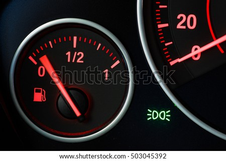 Fuel gage with motion blurred needle.