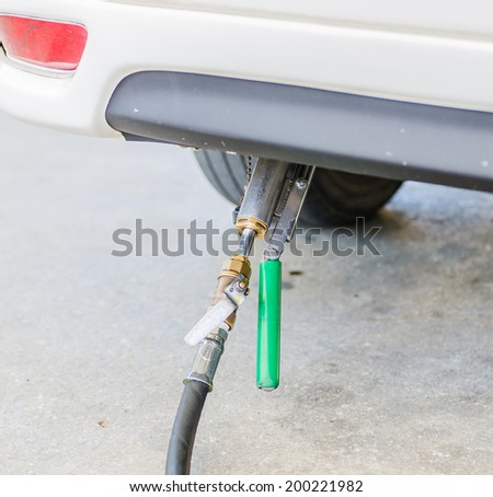 Fuel gas in car - stock photo