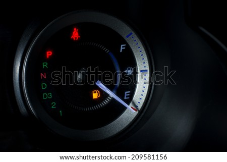 Fuel gauge dash board close up at night - stock photo