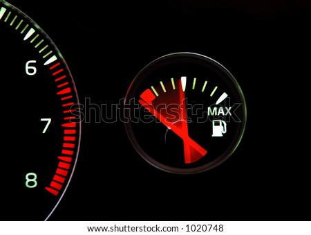 Fuel gauge on its way to empty - stock photo