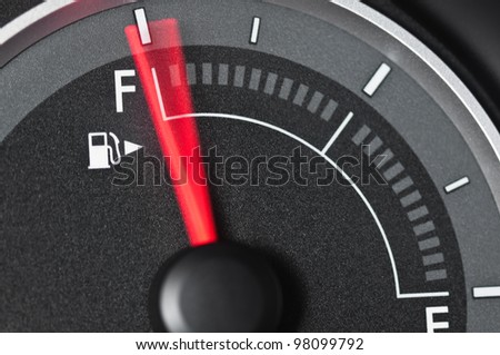 Fuel gauge with motion blurred needle - stock photo