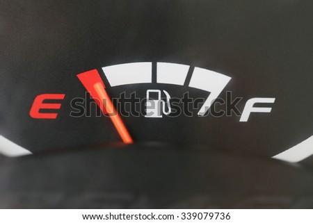 Fuel gauge with warning indicating low fuel tank,Gas gauge indicating white icon for gas station.