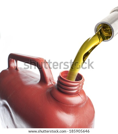 Fuel is poured into a plastic canister isolated on white background. - stock photo