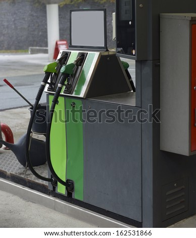 fuel nozzle at a gas station